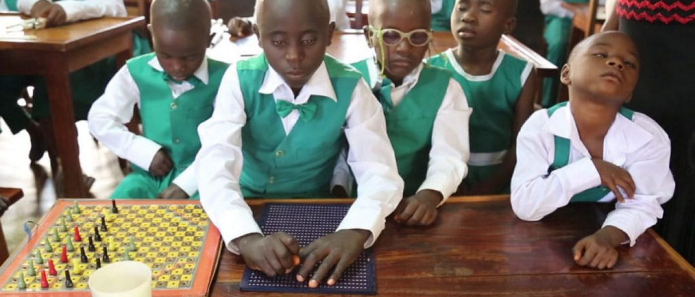 Children with visual impairment using braile to study