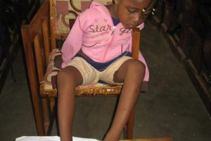 Training a child without hands to use legs to write